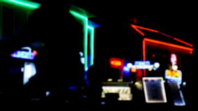 Street scene at night. Abstract urban city street scene at night, out of focus with lights and traffic moving by stock footage