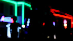 Street scene at night. Abstract urban city street scene at night, out of focus with lights and traffic moving by stock video