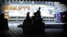 Street scene at night. Abstract urban city street scene at night, out of focus with lights and traffic moving by stock video footage