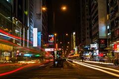 Street scene at night in Kowloon, Hong Kong Royalty Free Stock Images