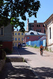 Street scene at noon with natives in old Vyborg neighbourhood Stock Photo