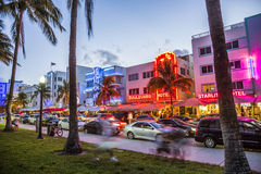 Street scene at the Ocean Drive in Miami. MIAMI, USA - AUG 23, 2014: Street scene at the Ocean Drive in Miami's Art Deco district in the twilight Stock Photography
