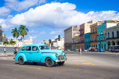 Street scene with old american car in downtown Havana Royalty Free Stock Image