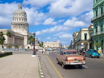 Street scene with old american car near the Capitol of Havana Royalty Free Stock Photos