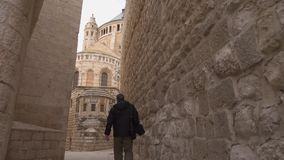 Street scene in old city of the Jerusalem in. JERUSALEM, ISRAEL - 2. JANUAR, 2015: street scene in old city of the Jerusalem in Israel .A man walks through the stock video footage