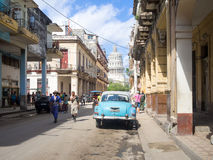 Street scene in Old Havana with people and an old american car Stock Photos
