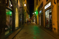 Street scene in the old town of Florence at night. Florence, Italy - July 03, 2016: street scene in Florence at night with unidentified people. Florence is a royalty free stock photography