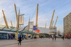 Street scene outside the O2 dome in Greenwich. Greenwich, London, UK - February 14, 2018: The O2 dome with its surrounding shops and restaurants.  People stock images