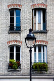 A street scene in Paris. An ordinary house wall in Paris, which shows the common life there Royalty Free Stock Photos