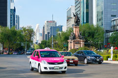 Street scene at Paseo de la Reforma in Mexico City near the Christopher Columbus statue. MEXICO CITY-DECEMBER 28,2016 : Street scene at Paseo de la Reforma in Stock Photos