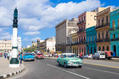 Street scene with people and old american cars in downtown Havana Royalty Free Stock Photos