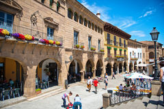 Street Scene in Poble Espanyol, Barcelona, Spain. View of Cafes and Pedestrian Traffic on Sunny Day in Historical Poble Espanyol District of Barcelona, Spain Stock Photography