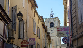 Street scene in Provence. Old building in a street with a church in the background, Provence, France Royalty Free Stock Images