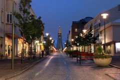 Street scene in Reykjavik, Iceland. Night view of Skolavordustigur street leading to the Hallgrimskirkja Church, one of the landmarks of Reykjavik, the capital Stock Photography
