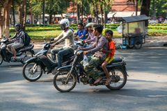 Street scene of scooters in Cambodia, South east Asia royalty free stock images