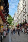 Street scene with souvenir shops in Montmartre with a view of the Sacre Coeur Basilica. PARIS,FRANCE -AUGUST 4,2017 Street scene with souvenir shops in Stock Photo