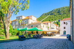 Street Scene, Ston. STON, CROATIA - JUNE 25, 2015: Typical street scene in the village of Ston, with restaurants, the old walls, locals and tourists. In Ston Stock Photography