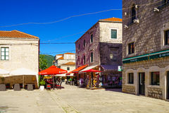 Street Scene, Ston. STON, CROATIA - JUNE 25, 2015: Typical street scene in the village of Ston, with shops, restaurants, the old walls, locals and tourists. In Stock Images