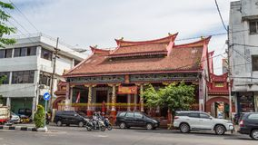 Street scene in Surabaya Indonesia. Surabaya, Indonesia - November, 04, 2017:  Street view with Chinese temple, bicycle taxi and other trafiic in in Surabaya Stock Photography