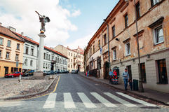 Street scene with tourists. Vilnius, Lithuania street scene with monument and stock image