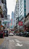Street scene typically Asian in Hong Kong. HONG KONG, ASIA - AUGUST 2, 2017; Street scene typical of Asian cities with tall buildings and plethora neon signs in Royalty Free Stock Photos