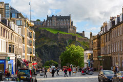 Street scene with view to the Edinburgh Castle Royalty Free Stock Photography