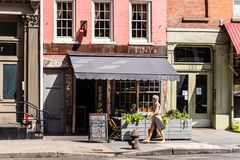 Street scene in West Broadway Street in Tribeca. New York City, USA - June 25, 2018: Street scene in West Broadway Street with traditional sidewalk cafe in royalty free stock image