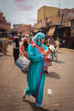 Street scene. Woman with baby. Marrakesh. Morocco Royalty Free Stock Image