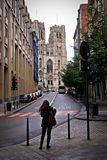 Street Scene with Woman and Cathedral Taken in Brussels, Belgium. royalty free stock photo