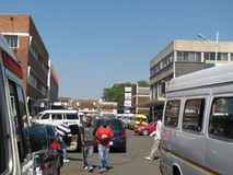 Street scene in Zimbabwe. Harare,Zimbabwe,October 18 2016.People and cars moving along a downtown street in Zimbabwe`s capital royalty free stock photos