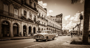 Street scenery on the main street with drive American vintage cars in Havana Cuba - Retro Serie SEPIA Cuba Reportage Stock Photos