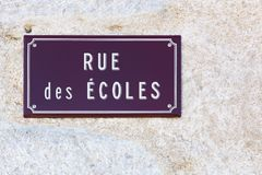 Street of schools sign on a wall in french. France Stock Images