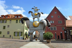 Street sculpture of horses. Bietigheim, Germany - April 19, 2016: Street sculpture of horses, placed one above the other, against the background of the old Royalty Free Stock Image