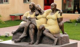 Street sculpture of three women in Taos royalty free stock images
