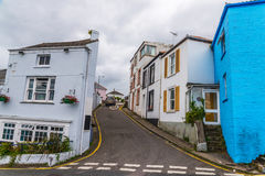 Street in a seaside town, with colorful facades of buildings, en Royalty Free Stock Image