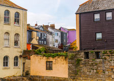 Street in a seaside town, with colorful facades of buildings, en Stock Images