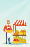 Street seller with fruits and vegetables. Greengrocer standing near the stall with fruits and vegetables. Greengrocer standing near the market stall Royalty Free Stock Photography