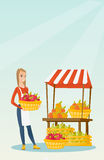 Street seller with fruits and vegetables. Greengrocer standing near the stall with fruits and vegetables. Greengrocer standing near the market stall Stock Photography
