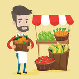 Street seller with fruits and vegetables. Street seller with stall with fruits and vegetables. Greengrocer standing near market stall. Hipster seller with the Stock Photos