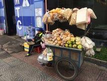 Street seller in Ho Chi Minh city in Vietnsm Stock Photo