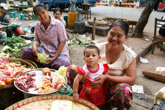 Street seller at the market of Yangon on Myanmar Royalty Free Stock Photo