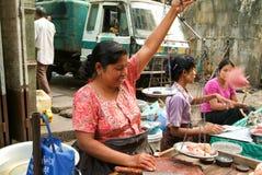 Street seller at the market of Yangon on Myanmar Stock Image