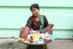 Street seller at the market of Yangon on Myanmar Royalty Free Stock Image