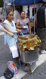 Street seller mexican tamales. Woman selling the traditional mexican oaxaca tamales in the street with a burner in the bottom stock images