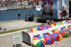 Street seller in Porto. Porto, Portugal - 12 July 2012. An umbrella seller in the street of Porto Stock Images