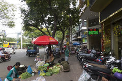 Street sellers in Ho Chi MInh, Vietnam royalty free stock photos
