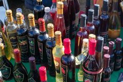 Street selling of homemade alcohol drink on popular event smoked meat fair called Prsutijada. stock photo