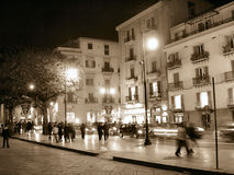 Street in sepia style, looking older and romantic. You can see people in movement, it looks like a 3D photo Stock Photos