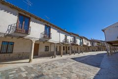 Street from seventeenth century in Ampudia village. Ancient pedestrian medieval street with arcaded buildings, landmark and monument from seventeenth century, in royalty free stock photos