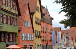 Street with several houses from the various colors and the many windows in the town of Dinkelsbuhl in Germany Royalty Free Stock Images